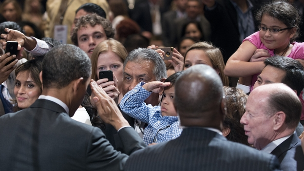President Obama returned a young fan's salute at the conference of the National Association of Latino Elected Officials in Orlando, Fla. (AFP)