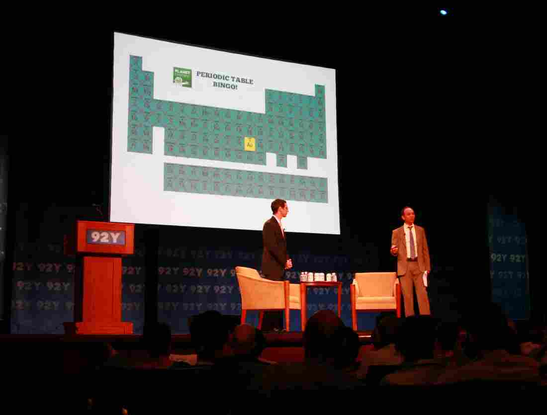 Jacob Goldstein and David Kestenbaum engaging the audience as they break down the history of money