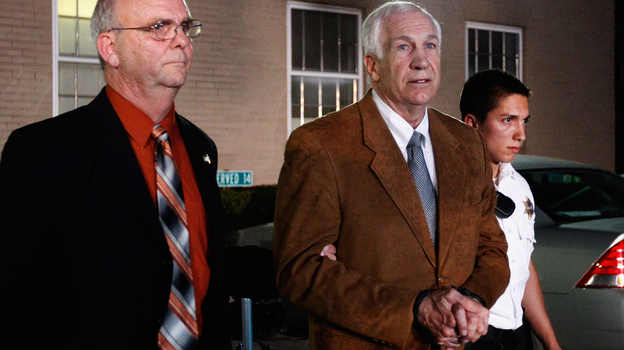 Former Penn State assistant football coach Jerry Sandusky leaves the Centre County Courthouse in handcuffs after a jury found him guilty on 45 of 48 charges in his sex abuse trial in Bellefonte, Pa., Friday. (Getty Images)