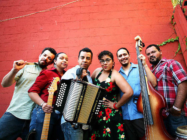 Singer Marisol Hernandez (center) takes listeners from her grandfather's burro cart to La Santa Cecilia's Latin Grammy Award, on Olvera Street in Los Angeles.