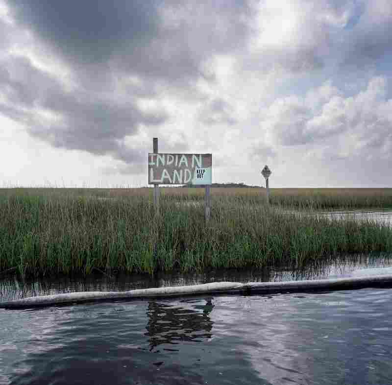 Stranded Indian Land with Oil Boom, after the British Petroleum Oil Spill, South of Point-aux-Chenes, Louisiana, 2010