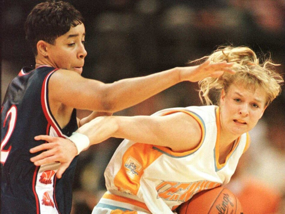 Michelle Marciniak (right) of the University of Tennessee Lady Volunteers attempts to elude the defensive pressure of Nykesha Sales of the UConn Huskies during the 1996 NCAA Women's Final Four. (Getty Images)