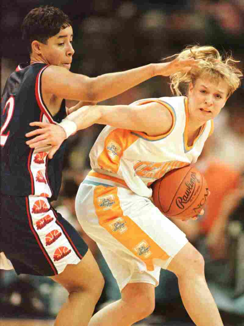 Michelle Marciniak (right) of the University of Tennessee Lady Volunteers attempts to elude the defensive pressure of Nykesha Sales of the UConn Huskies during the 1996 NCAA Women's Final Four.