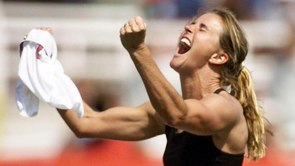 Brandi Chastain celebrates after kicking the winning penalty shot to win the 1999 Women's World Cup final at the Rose Bowl in Pasadena, Calif., in 1999. (AFP/Getty Images)