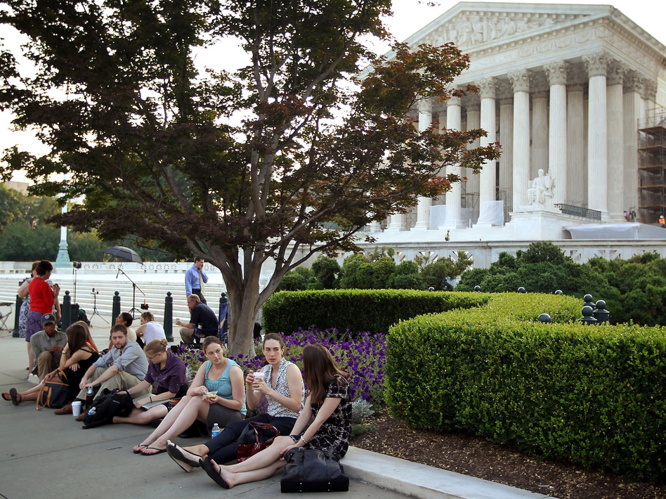 People wait outside the Supreme Court last week for word on the fate of the federal health overhaul law. (Getty Images)