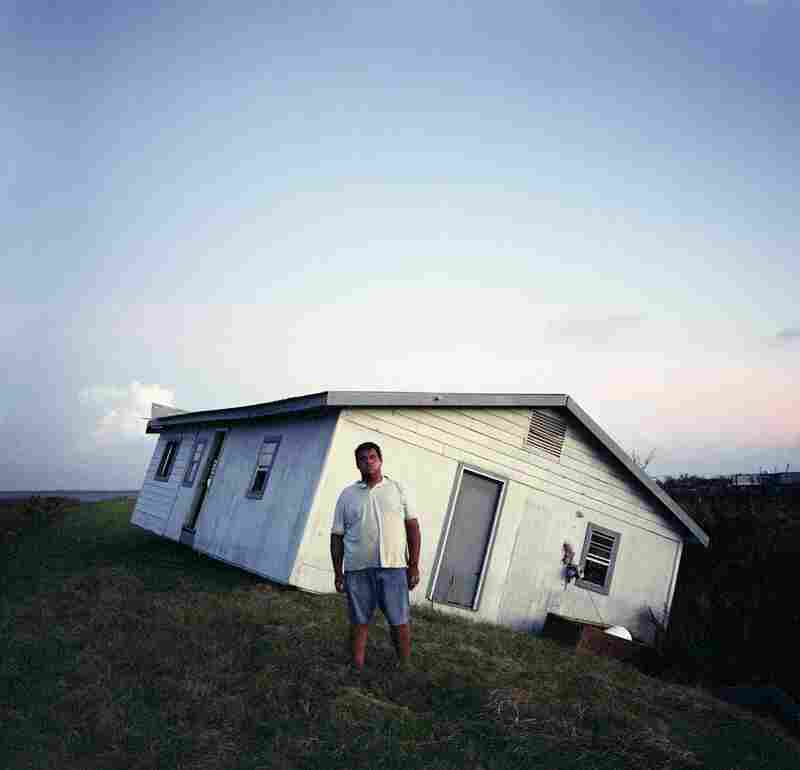 Walter Dardar Jr., with His Father's House after Hurricanes Gustav and Ike, Isle de Jean Charles, Louisiana, 2008