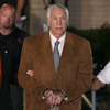 Former Penn State assistant football coach Jerry Sandusky leaves court in handcuffs Friday after being convicted in his child sex abuse trial at the Centre County Courthouse in Pennsylvania.