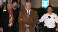 Former Penn State assistant football coach Jerry Sandusky leaves court in handcuffs after being convicted in his child sex abuse trial at the Centre County Courthouse in Pennsylvania Friday.
