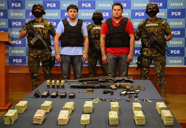 """On Thursday, the Mexican Navy presented Felix Beltran Leon (in red) as the son of Joaquin """"El Chapo"""" Guzman, Jesus Alfredo Guzman Salazar. On Friday, Mexican and U.S. officials confirmed that Beltran's identity had been mistaken."""