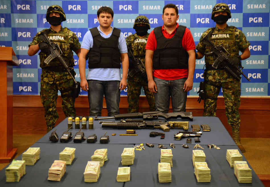 "On Thursday, the Mexican Navy presented Felix Beltran Leon (in red) as the son of Joaquin ""El Chapo"" Guzman, Jesus Alfredo Guzman Salazar. On Friday, Mexican and U.S. officials confirmed that Beltran's identity had been mistaken."