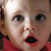 Human baby Charlotte, the 13-month-old daughter of NPR producer Tom Bullock, tried the same tests that DeeChee, the robot, does for language-learning experiments. Dr. Caroline Lyons says human babies have an advantage: They spend every waking hour of the day in a speaking world.