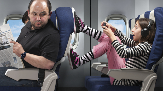 Some parents say the hardest part of flying with young kids on an airplane is dealing with unpredictable kids and adult passengers. (iStockphoto.com)