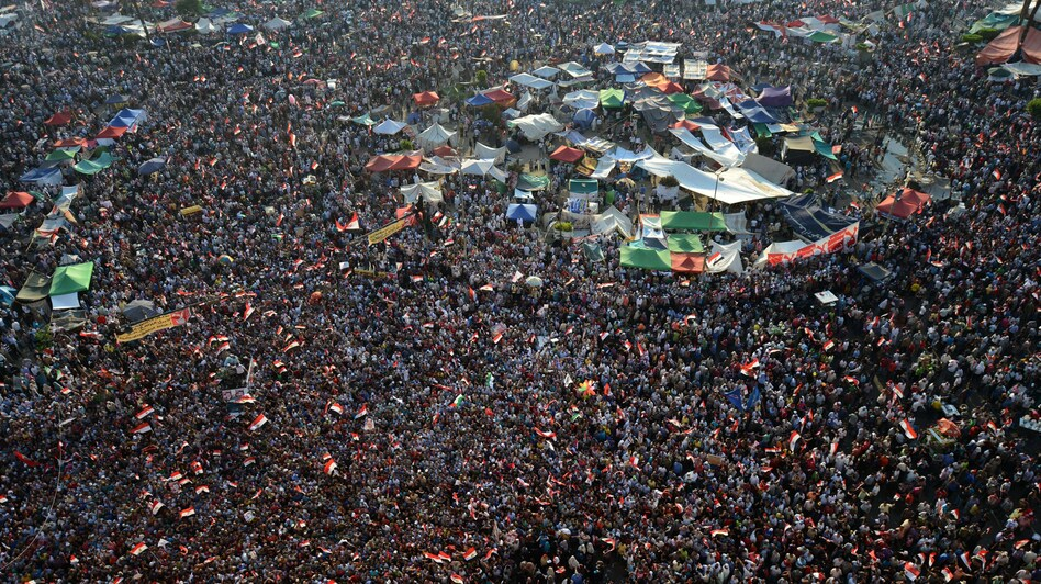 Thousands of Egyptians celebrate on in Cairo's Tahrir Square following the announcement that Muslim Brotherhood member Mohamed Morsi would be Egypt's next president. (AFP/Getty Images)