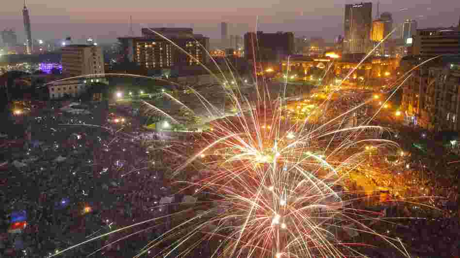 Fireworks illuminate Tahrir Square in Cairo, Egypt, on Sunday to celebrate the victory of Mohammed Morsi in the country's presidential election.