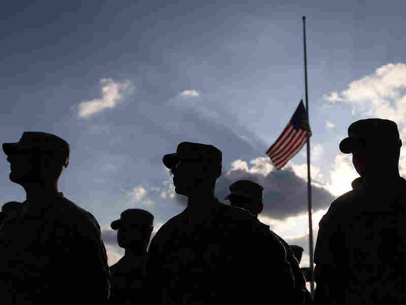 U.S. Army soldiers attend a Nov. 10, 2010, service for the 13 people killed in the shooting rampage five days earlier at Fort Hood.