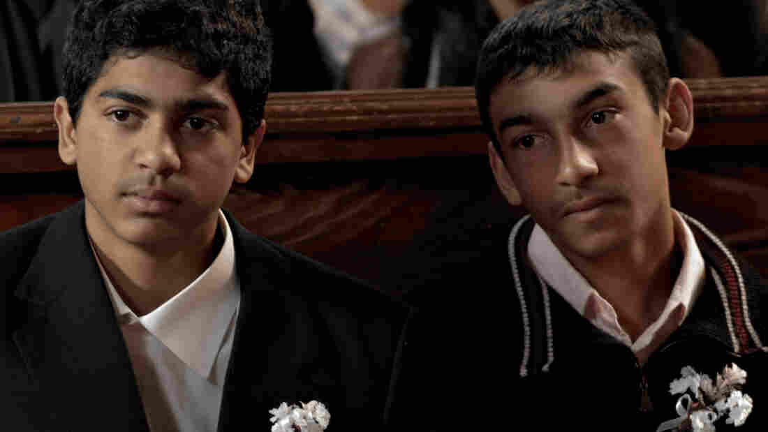 Adam (Jan Mizigar, left) sits with his glue-sniffing brother, Marian (Martin Hangurbadzo). Adam tries to avoid a path of crime in Gypsy, but family regularly draws him into one.
