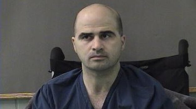 The FBI is investigating more than 100 suspected Muslim extremists who are part of the U.S. military community, officials tell NPR. U.S. authorities have increased scrutiny since the 2009 shooting attack at Fort Hood, Texas, that left 13 dead. Maj. Nidal Hasan, charged with the killings, is shown here in an April 2010 court hearing. (Getty Images)