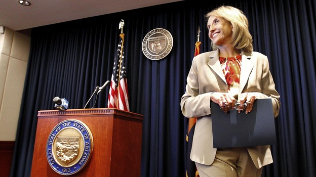 """Arizona Republican Gov. Jan Brewer leaves a podium at the state Capitol in Phoenix after responding to President Obama's immigration speech on June 15. Brewer said the speech represented a """"pre-emptive strike"""" aimed at what then was an upcoming Supreme Court ruling on Arizona's immigration law. (AP)"""