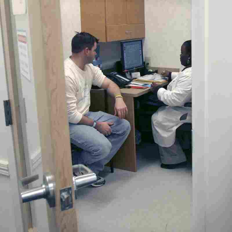 Shanda Johnson, right, a nurse practitioner, interviews patient Bill Gilligan at a MinuteClinic at the CVS drug store in North Brunswick, N.J.