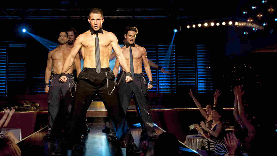 Mike (Channing Tatum, center) strips down in Steven Soderbergh's latest, Magic Mike -- and reveals some previously unseen acting chops.