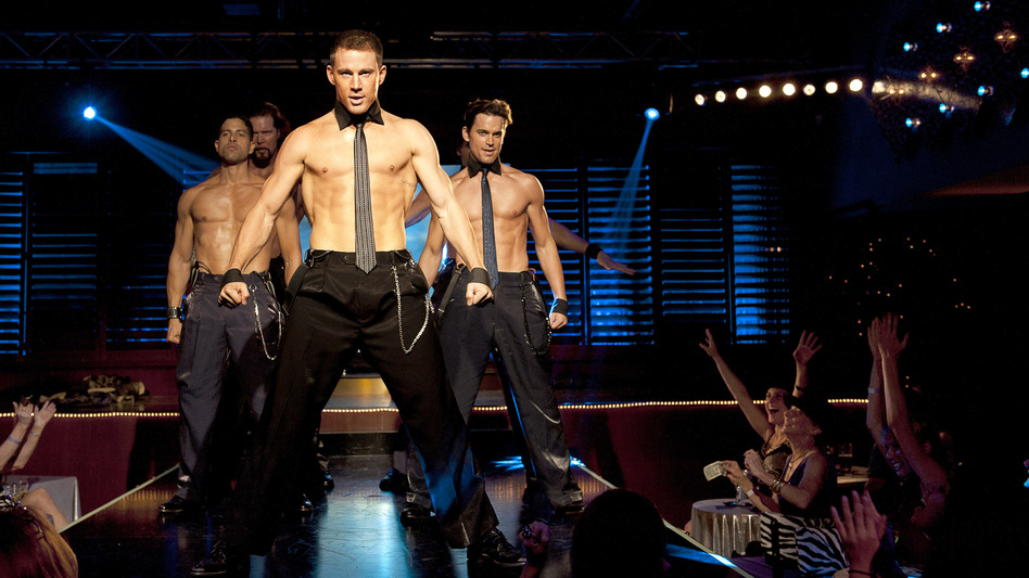 Mike (Channing Tatum, center) strips down in Steven Soderbergh's latest, Magic Mike -- and reveals some previously unseen acting chops. (Warner Bros. Pictures)