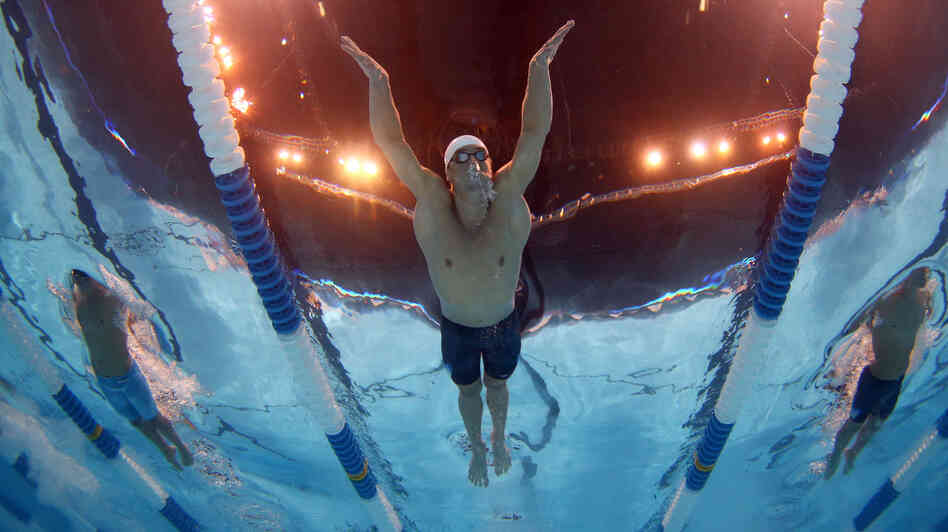 Michael Phelps swims in a preliminary heat at the 2012 U.S. Olympic