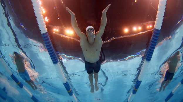 Michael Phelps swims in a preliminary heat at the 2012 U.S. Olympic Trials in Omaha, Nebraska. Phelps and rival Ryan Lochte were awoken from their afternoon naps by a fire alarm at their hotel Monday. (Getty Images)