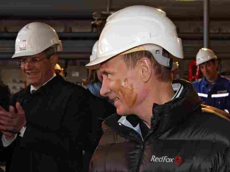 Then-Prime Minister Vladimir Putin greases his face with oil during a visit to a Lukoil oil platform in the Caspian Sea on April 28, 2010. Putin, who is now president for the second time, has been building up naval forces in the Caspian to combat challenges from neighbor countries to its control of the sea's oil and gas wealth.