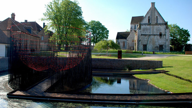 Andy Cao and Xavier Perrot's Red Bowl installation in Beauvais, France, recalls the way lepers once bathed in animal blood in an effort to cure themselves and avoid being ostracized to the one-time leprosarium where the installation is located. (Courtesy of Cao | Perrot Studio)