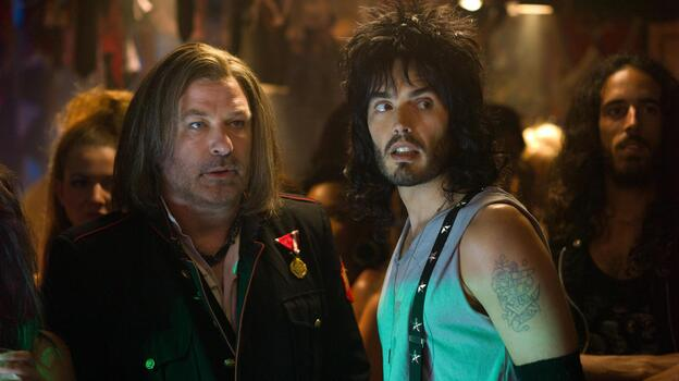 Club owner Dennis Dupree (Alec Baldwin, left) and his assistant Lonny Barnett (Russell Brand) try to figure out a way to keep their nightclub open in the movie adaptation of Rock of Ages. (David James)