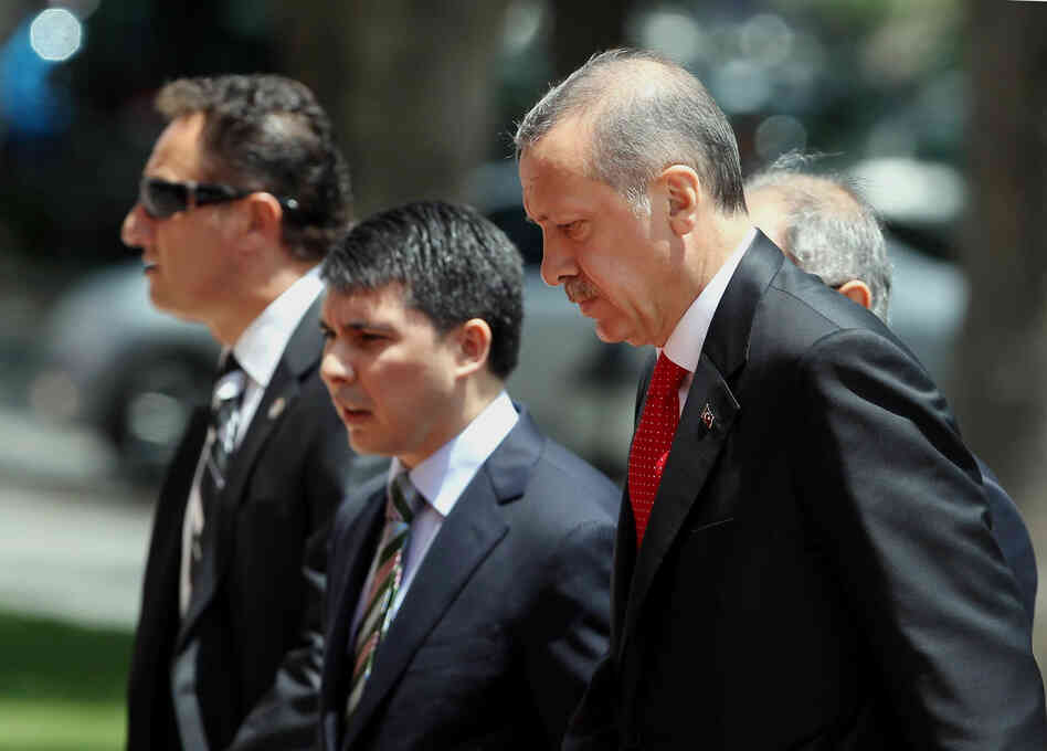 Turkish Prime Minister Recep Tayyip Erdogan, right, arrives for a cabinet meeting in his office in Ankara, Turkey on Monday.