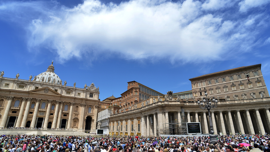 People gather on St. Peter's square to hear Pope Benedict XVI at the Vatican Sunday. The Vatican has hired Fox News correspondent Greg Burke to advise its press office. (AFP/Getty Images)