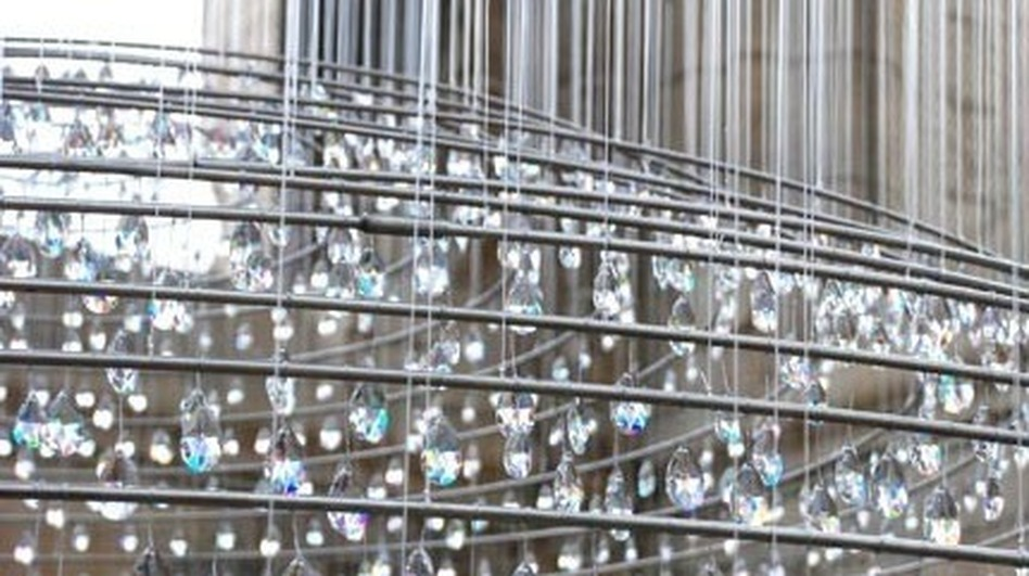 According to the artists' website, the crystals that hang in the tower are meant to serve as symbols of the soul's purification by ascension to heaven. (Courtesy of Cao | Perrot Studio)