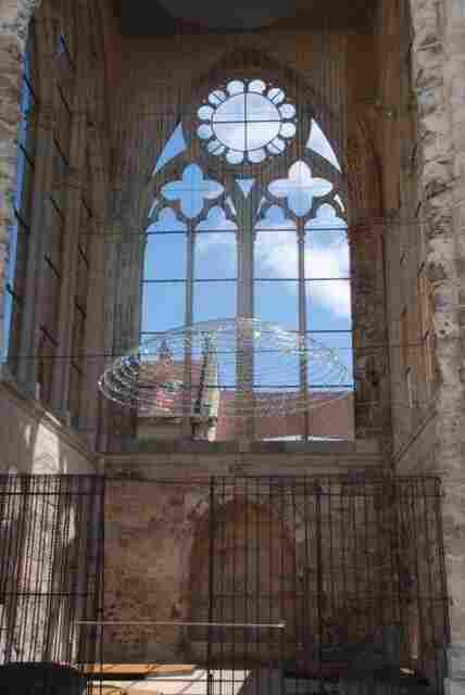 Cao and Perrot's White Dome hangs inside a free-standing tower that used to be part of Beauvais' Saint-Barthelemy Collegiate Church.