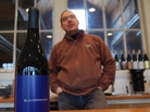 New York Winemaker Christopher Tracy and a bottle of his Blaufrankisch. The wine's difficult to pronounce name may attract oenophiles.
