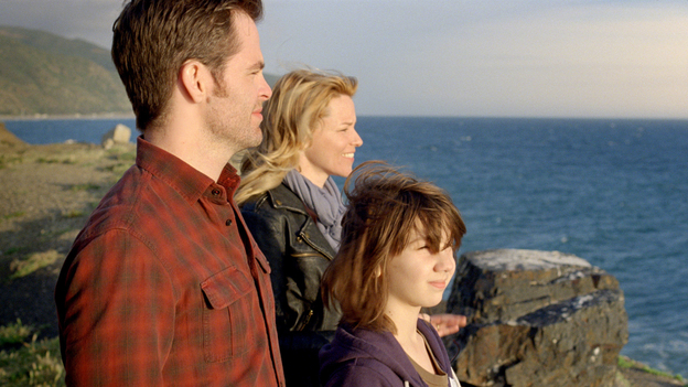 In People Like Us, Sam (Chris Pine) connects with Frankie (Elizabeth Banks) and her son, Josh (Michael D'Addario), without telling them that he is their long-lost brother and uncle, respectively. (Walt Disney Pictures)