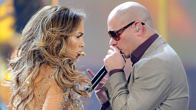 Jennifer Lopez and Pitbull perform onstage at the 2011 American Music Awards in Los Angeles.