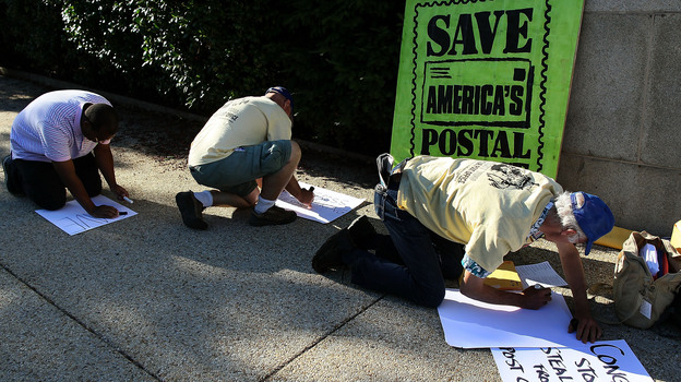 Postal workers and activists make signs for their hunger strike in front of the Rayburn House Office building in Washington, D.C.