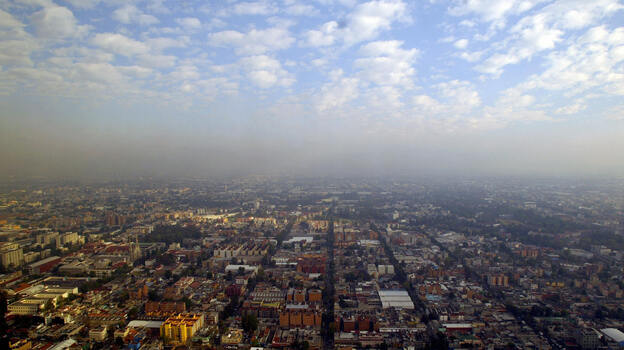 """In heavily polluted Mexico City, crime writer Paco Ignacio Taibo II describes his exhausted detective Hector Belascoaran Shayne as looking out at his hometown and seeing """"a city that was trying to hide itself in the smog."""" (AFP/Getty Images)"""