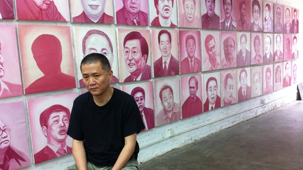 Artist and filmmaker Zhang Bingjian sits in his Beijing studio in front of his Hall of Fame — portraits of corrupt Chinese officials. He has commissioned portraits of 1,600 officials convicted of corruption. (NPR)