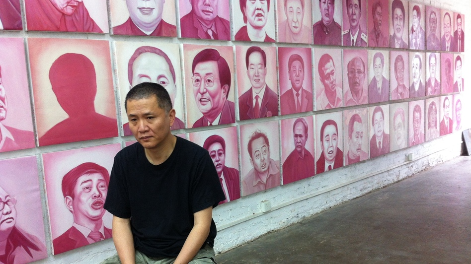 Artist and filmmaker Zhang Bingjian sits in his Beijing studio in front of his Hall of Fame — portraits of corrupt Chinese officials. He has commissioned portraits of 1,600 officials convicted of corruption.