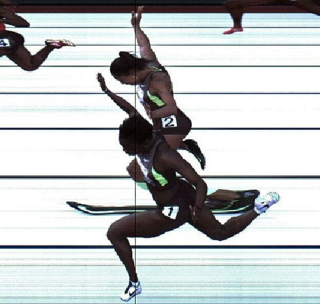 In this handout photo provided by the USATF, Jeneba Tarmoh (bottom, lane 1) and Allyson Felix cross the finish line at exactly the same time in the women's 100 meter dash final during Day Two of the 2012 U.S. Olympic Track & Field Team Trials at Hayward Field on Saturday in Eugene, Ore. It's their torsos, not head, hands, feet or arms, that matter.