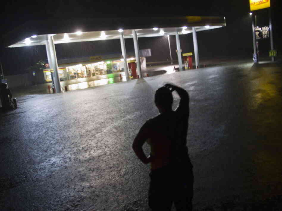Convenience store employee Lindsey Bennight watched floodwaters surround the store where she works in Crawfordville, Fla., on Monday (June 25, 2012).