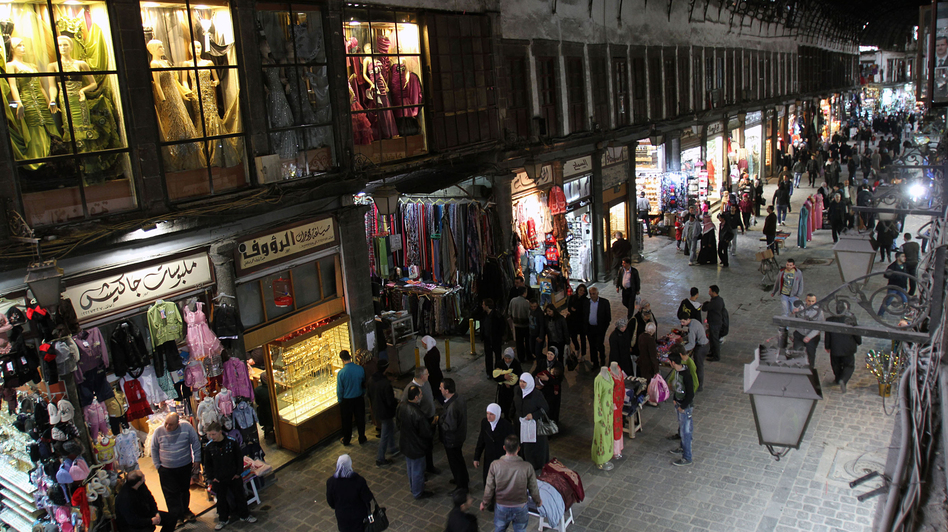 People walk through Hamidiyah market in Damascus, Syria, Feb. 28. The merchants of this landmark bazaar were once ardent supporters of President Bashar Assad. That's no longer the case. (Bassem Tellawi/AP)