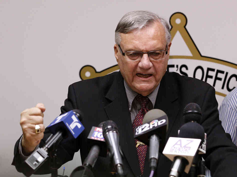 A defiant Maricopa County Sheriff Joe Arpaio answers questions about the Justice Department's lawsuit against him during a news conference in Phoenix last month.
