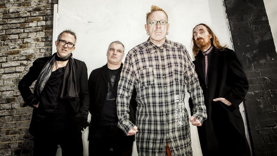 John Lydon (center right) of Public Image Ltd. (Courtesy of Paul Heartfield)