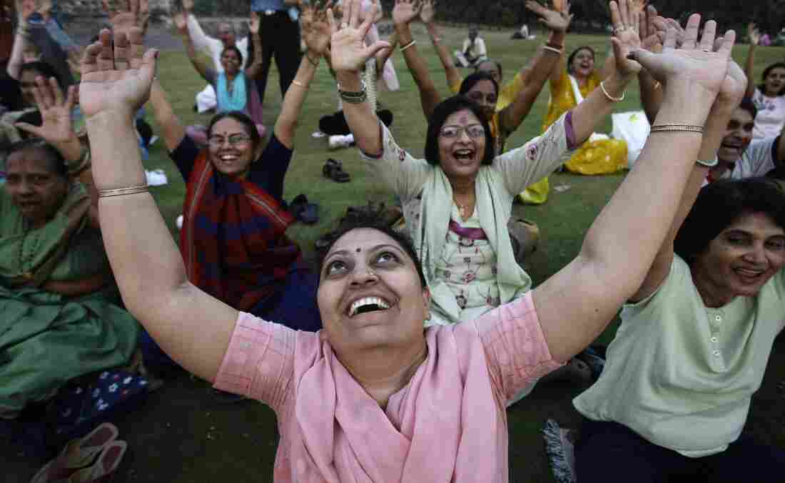 People participate in a Laughter Yoga session in Mumbai, India.