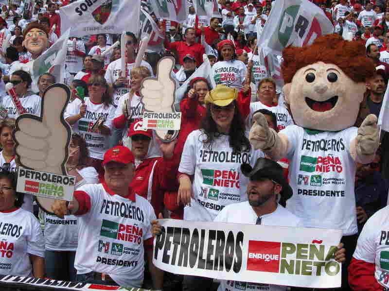 An estimated 100,000 people turned out for Pena Nieto's rally Sunday at Azteca Stadium in Mexico City.