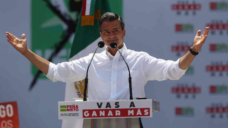 PRI candidate Enrique Pena Nieto campaigns in Mexico City. Pena Nieto is heavily favored in Mexico's presidential election on Sunday. H