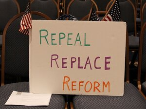A sign reading 'Repeal Replace Reform' sits on a chair during a news conference at the National Press Club on A
